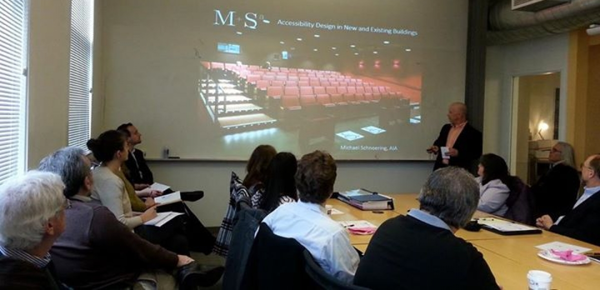 Attendees view a presentation on Facility Access