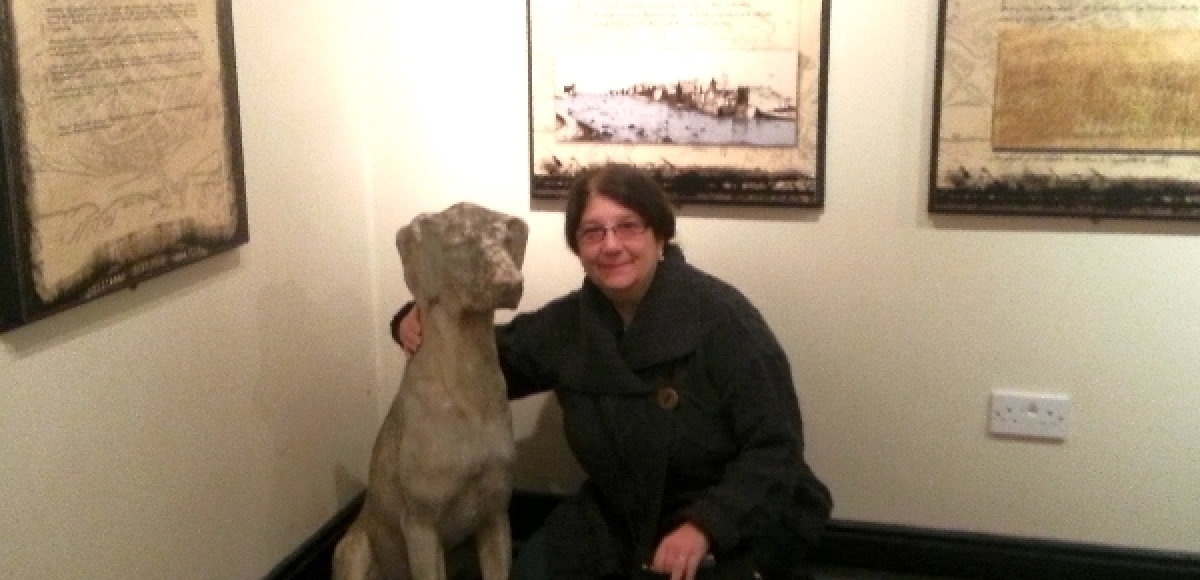 Veronica with her new canine companion in the cellars of Roscommon House in Ireland