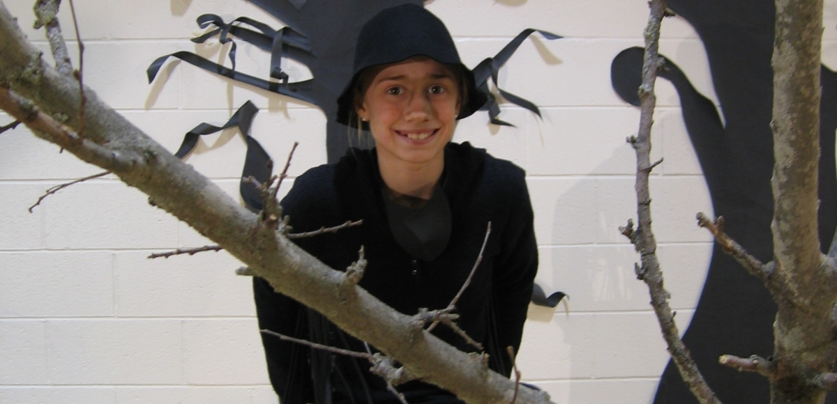 """A student playing the Crow in """"Aesop's Fables"""""""