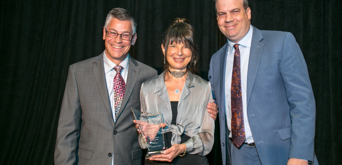 John McEwen (left) and John Wooten present Maria Lupo of Atlantic Health System's Healing Arts Program with the Star Award at Curtain Call 2017. Photo by Jerry Dalia