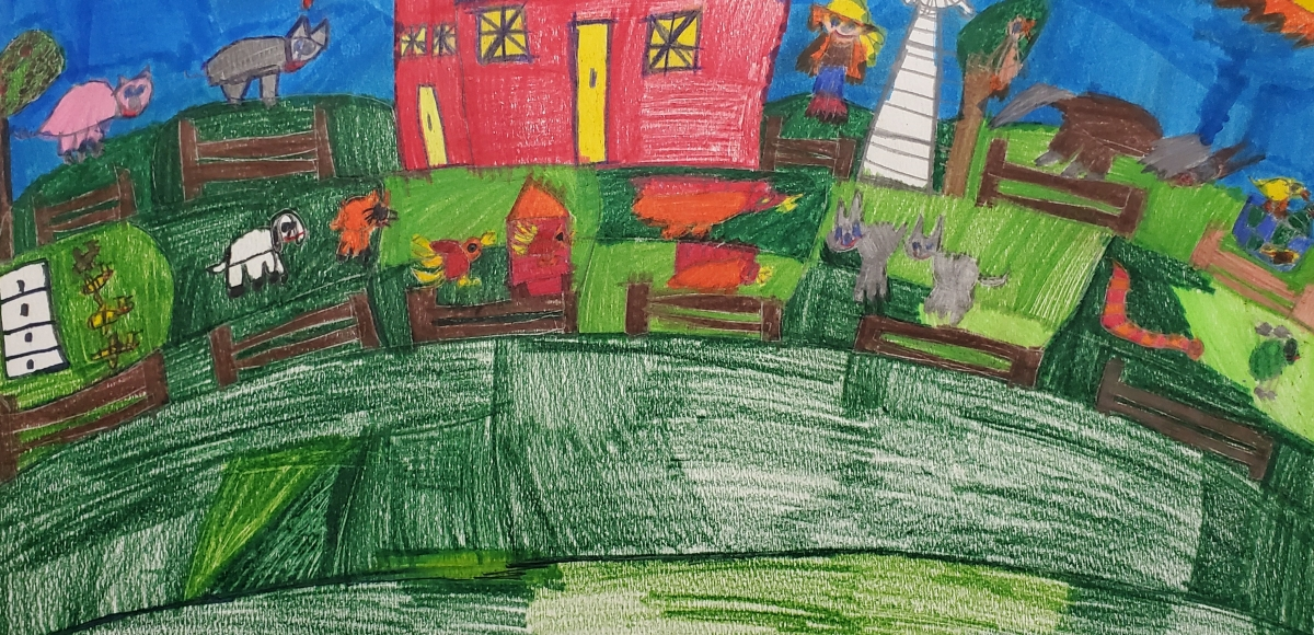 Farm with red barn, green field, animals