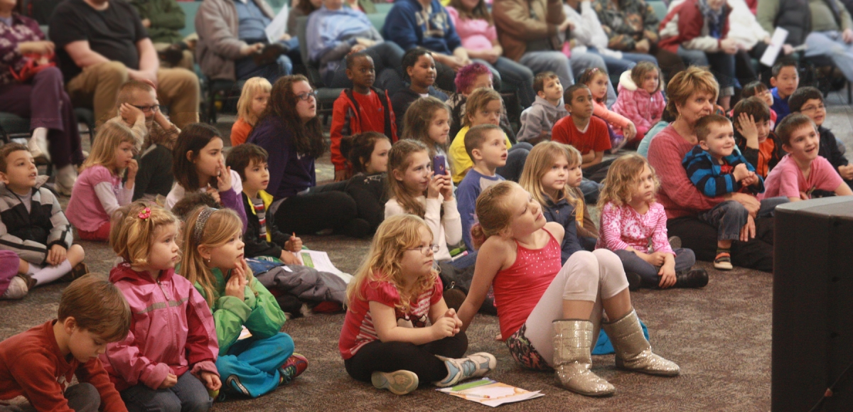 Crowd of children viewing show for young audiences