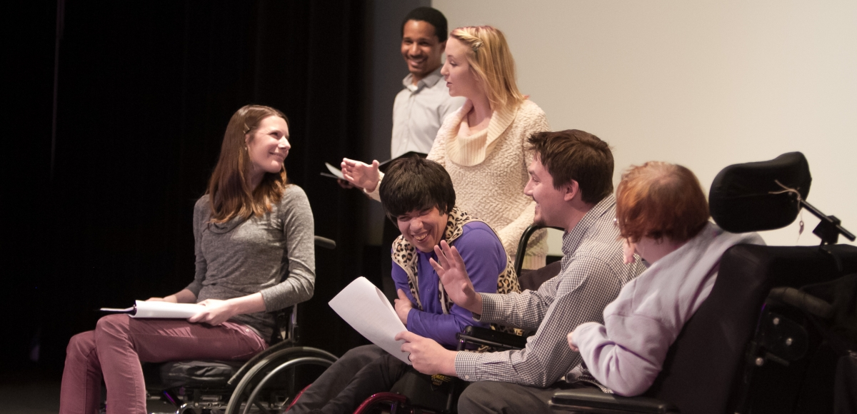 Theatre artists with disabilities develop their plays with professional actors through the Matheny Medical and Educational Center's Arts Access Program. From left to right, in back: actors Heather Kelley, Samuel Stricklen, and Cara Gansk of Premiere Stages; in front: playwright Tatyana Manousakis, Matheny Performing Arts Coordinator Burt Brooks, and playwright Cheryl Chapin. Photo by Jerry Dalia.
