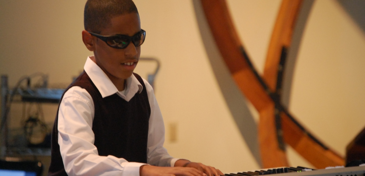A young musician with disabilities performs at New Jersey Theater Alliance's CAN Awards, celebrating individuals and organizations who help make the arts accessible.