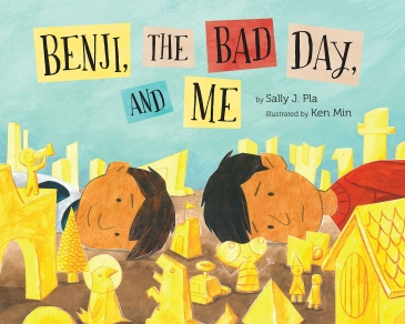 cover photo for benji, the bad day and me - two brothers laying down head to head among a bunch of yellow toys and figurines