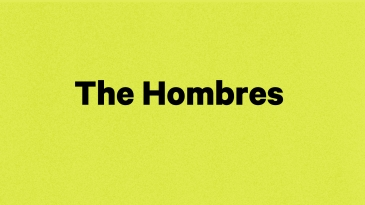 """show title """"The Hombres"""" in black text on a yellow background"""