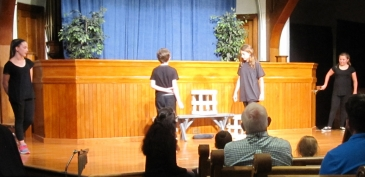 Students performing STORY THEATER